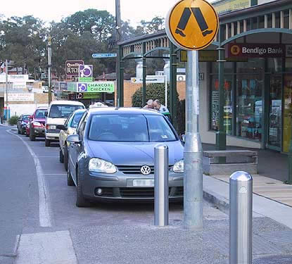 Stainless steel bollards at pedestrian crossing