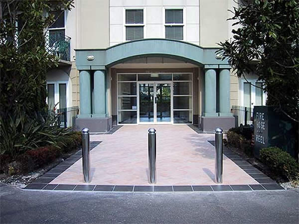 Stainless steel bollards in building forecourt