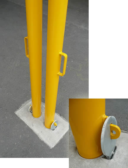 Close-up of in-ground sleeve and storm barrier bollard in postion